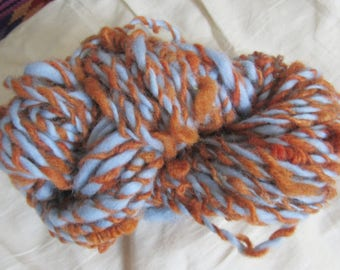 Copper and periwinkle hand-spun kinky wool 2 ply yarn
