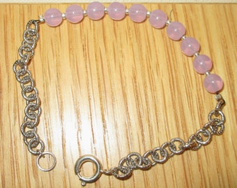 Elegant and feminine Bracelet (silver plated chain and pink beads)