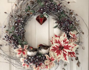 Christmas wreath, winter outdoor nature theme in snowy white and red