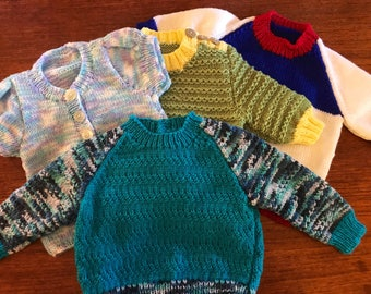 Hand knitted wool baby jumpers