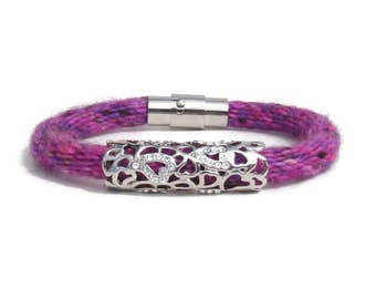 Woven pink and purple hand dyed specialty yarn kumihimo bracelet with rhinestone charm and stainless steel magnetic clasp