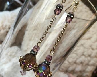 Vintage repurposed earrings with purple aurora crystal and rhinestone spacer beads