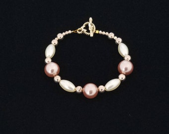 White and Champagne Colored Beaded Bracelet with Rose Gold Colored Accent Beads