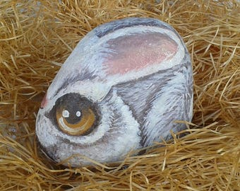 Painted bunny on a river Stone