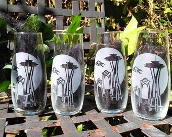 Etched Champagne Glasses with space needle and the Fair arches