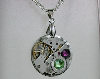 Watch movement  Steampunk   Pendant with Peridot , Amethyst  Swarovski crystal ,  Steampunk Jewelry , Steampunk Jewelry , Clockwork Pendant
