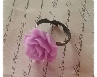 Ring with a pale mauve resin flower