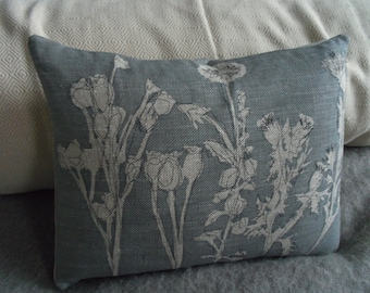 hand printed and stitched little muted blue meadow cushion