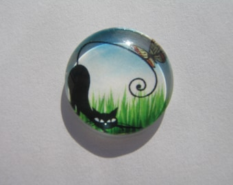Glass cabochon round 20 mm with his cat in the grass image