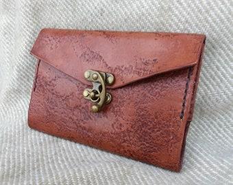 Leather covered Moleskine pocket notebook