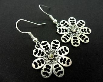 A hand made tibetan silver  flower themed  dangly earrings.
