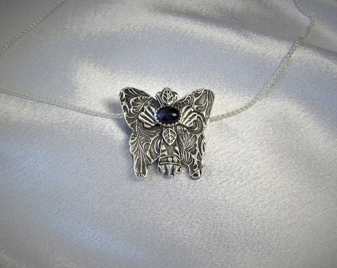 """Item 6119 - """"Wisdom and Hope""""  999 Fine and 925 Sterling Silver Carved Textured Cross Butterfly Lab Sapphire Necklace"""
