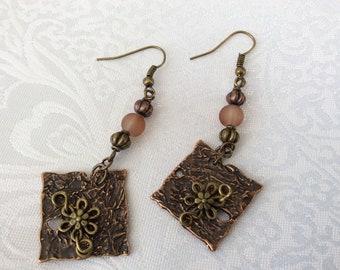 Bronzetone and Coppertone drop earrings on bronzetone earwires