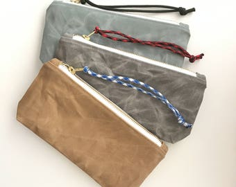waxed canvas clutch with interior pocket
