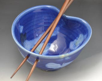 "Rice Bowl Blue base glaze with light blue brushed glaze, and slip squiggles Stoneware  3"" tall x 5.75"" with chopsticks"