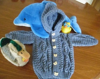 Boy's hoodie, handknit in blue denim acrylic yarn and finished with 6 tiger buttons.