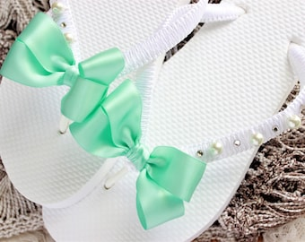 White bridal flip flops with Mint Green Bow. Wedding flip flops for brides. Beach wedding shoes with pearls and crystals