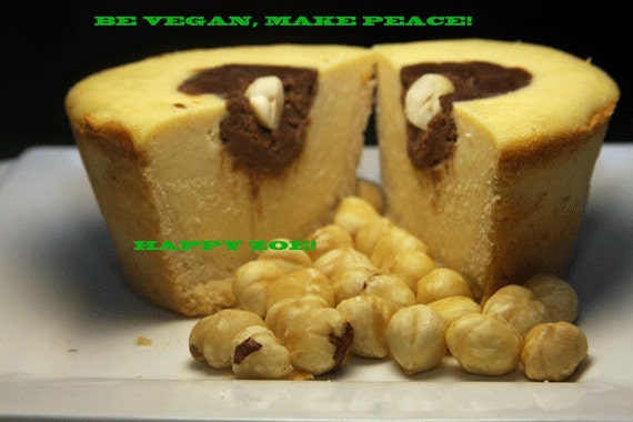 Vegan delicious creamy vanilla baby cheesecakes and creamy raw nutella hazelnut filling, love,no dairy. Perfect for Valentine's Day.