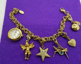 Kirks Folly Charms and Watch Quartz Ladies Watch Angels Stars Fantasy Gold tone Working Wrist watch