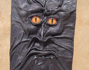 Grichels leather mini notebook - black with poppy orange slit pupil reptile eyes