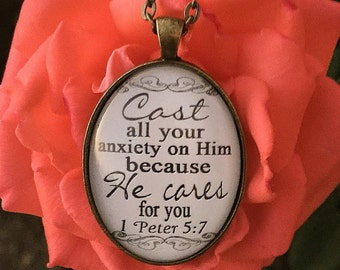 """Oval Bible Verse Pendant Necklace """"Cast all your anxiety on Him because He cares for you. 1 Peter 5:7"""""""