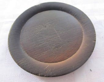 Old wooden round plate serving saucer