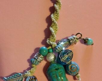 Free shipping. Turquoise Buddha hemp key chain.