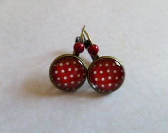 Red lever back earrings with white dots