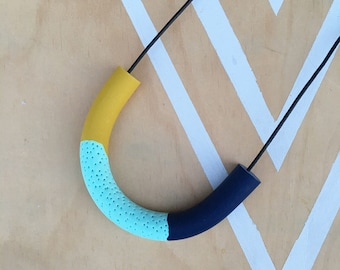 Polymer clay necklace. Polymer clay curved bar pendant. Mixed colours navy, mustard and mint  'The Eva'