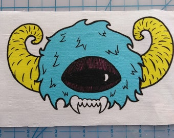 Blue and Yellow Monster Head Patch