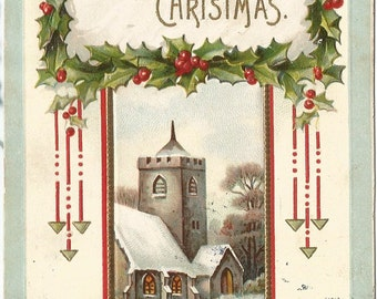 Country Christmas in a Snow covered Winter Church Scene Vintage Postcard A Happy Christmas Framed in Holly Branches