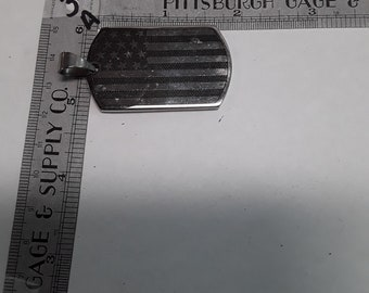Silver toned American flag pendant used
