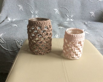 Jars covered with crochet sleeves