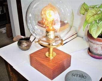 Special cherry table lamp with a glass globe on an extended nautical style brass globe holder and an IN-LINE DIMMER switch