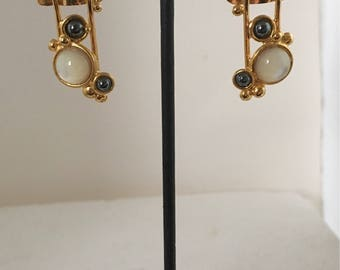 Gold plated brass rectangle stud earrings with gold plated brass wire accents and hematite and mother of pearl stones