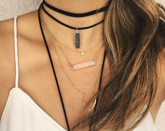 Quartz bar necklace.