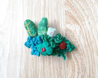 Nature inspired needle felted brooch/pin. Leaves, flowers, wool embellishments.