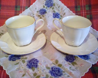Gold trimmed tea cups and saucers