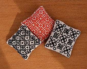 Blackwork Cushion, one inch scale dolls house pillow, hand embroidered dollhouse miniature in 1/12 scale