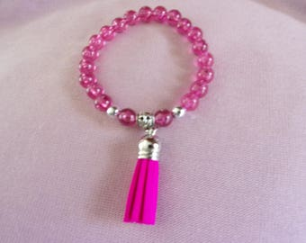 Pink stretch bracelet with 38mm tassel