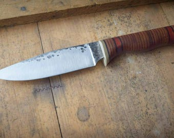 Hand forged hunter with stacked leather