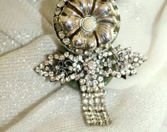 Brooch of Silver plate, and Rhinestones in a lovely floral theme.