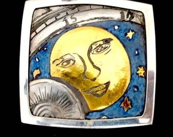 A hand engraved pendant: Tick-Tock Moon
