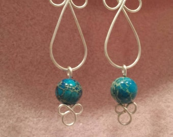 Celtic knot earrings with a floating stone.
