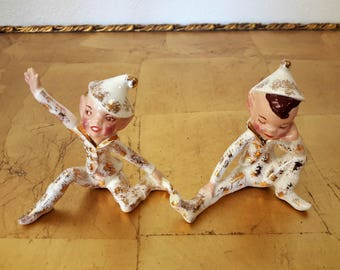 Pair Of Pixie Elfs or Elves in Pajamas Ceramic Figurines  Possibly Dancing Or Stretching Pixies