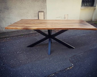 Live edge wooden table on central X frame