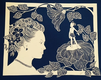 Custom paper cut with element of portrait