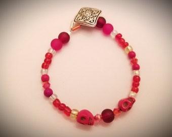 Vibrant orange toned skull and beaded bracelet