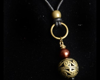 Necklace bronze glass and antique brass long black leather ball