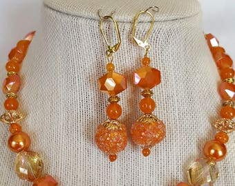"ladies ""orange crush"" faceted beaded necklace and earring set"